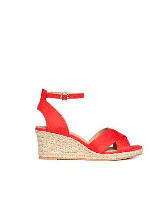 clothing companies that support worthy causes: H&M - Wedge-heel Sandals