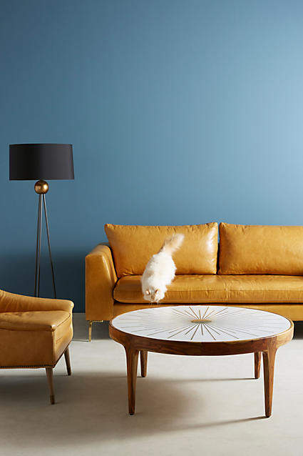 living room inspiration: Anthropologie Brass Starburst Round Coffee Table