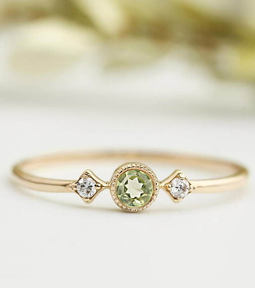 August Birthstone: Peridot. This dainty, art deco style ring from EnveroJewelry would make a lovely and unique engagement ring for Leos. #peridot #AugustBirthstone #vibealchemist