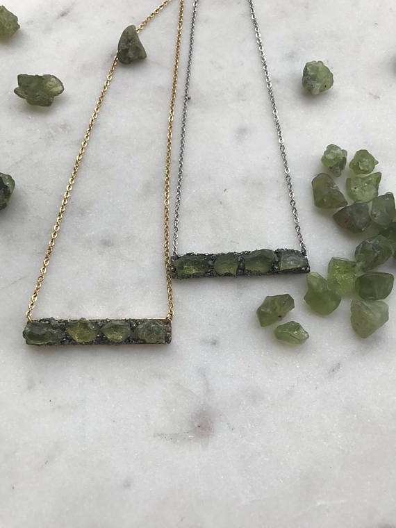 August Birthstone: Peridot. This raw peridot necklace is from GaiaBohemeJewellery and is the perfect way to keep peridot close to your heart chakra. #peridot #AugustBirthstone #vibealchemist