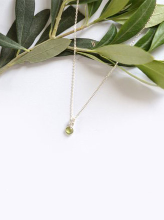 August Birthstone: Peridot. This danity peridot necklace is from RubyJunejewellery and is the perfect way to keep peridot close to your heart chakra. #peridot #AugustBirthstone #vibealchemist