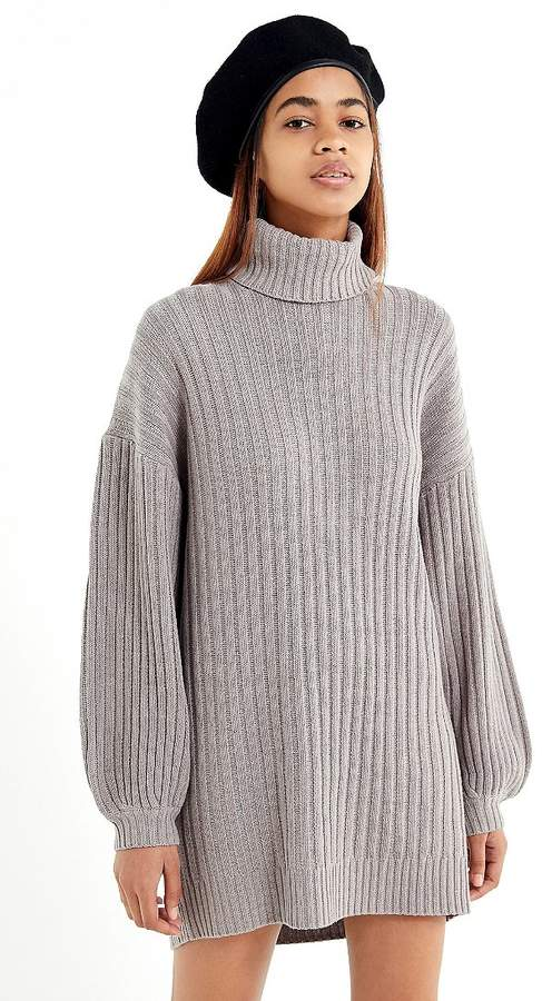 Sweater Weather: Too cozy to care in this mini sweater dress from UO. Made from a soft ribbed knit fabric in a super relaxed fit. Topped with a rolled turtleneck + dropped long sleeves; banded cuffs + hem. #urbanoutfitters #sweaterweather