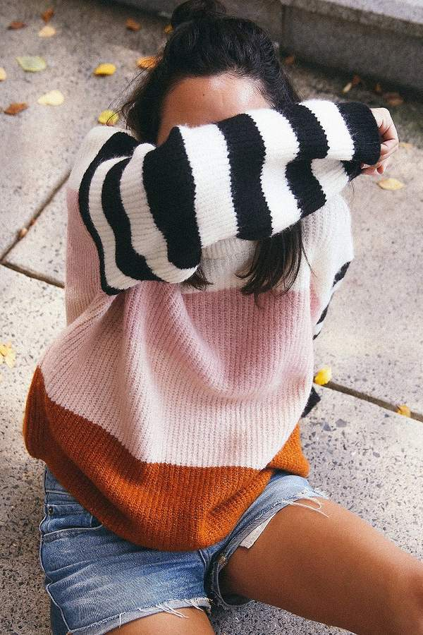 Sweater Weather: New favorite sweater from Truly Madly Deeply. Easy pullover silhouette cut to the waist in a boxy fit with wide sleeves. #urbanoutfitters #TrulyMadlyDeeply